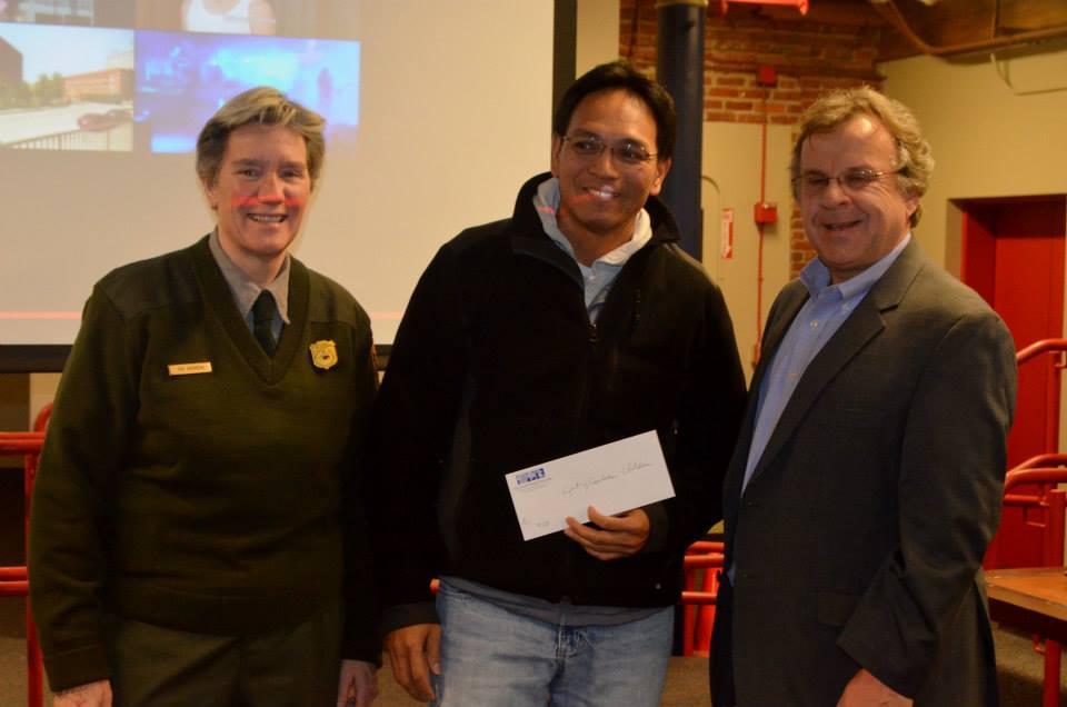 Sayon Soeun accepts on behalf of Light of Cambodian Children